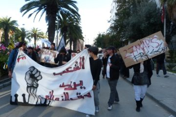 Solidarity for arrested graffiti artist @ the opening march of the WSF Tunis.